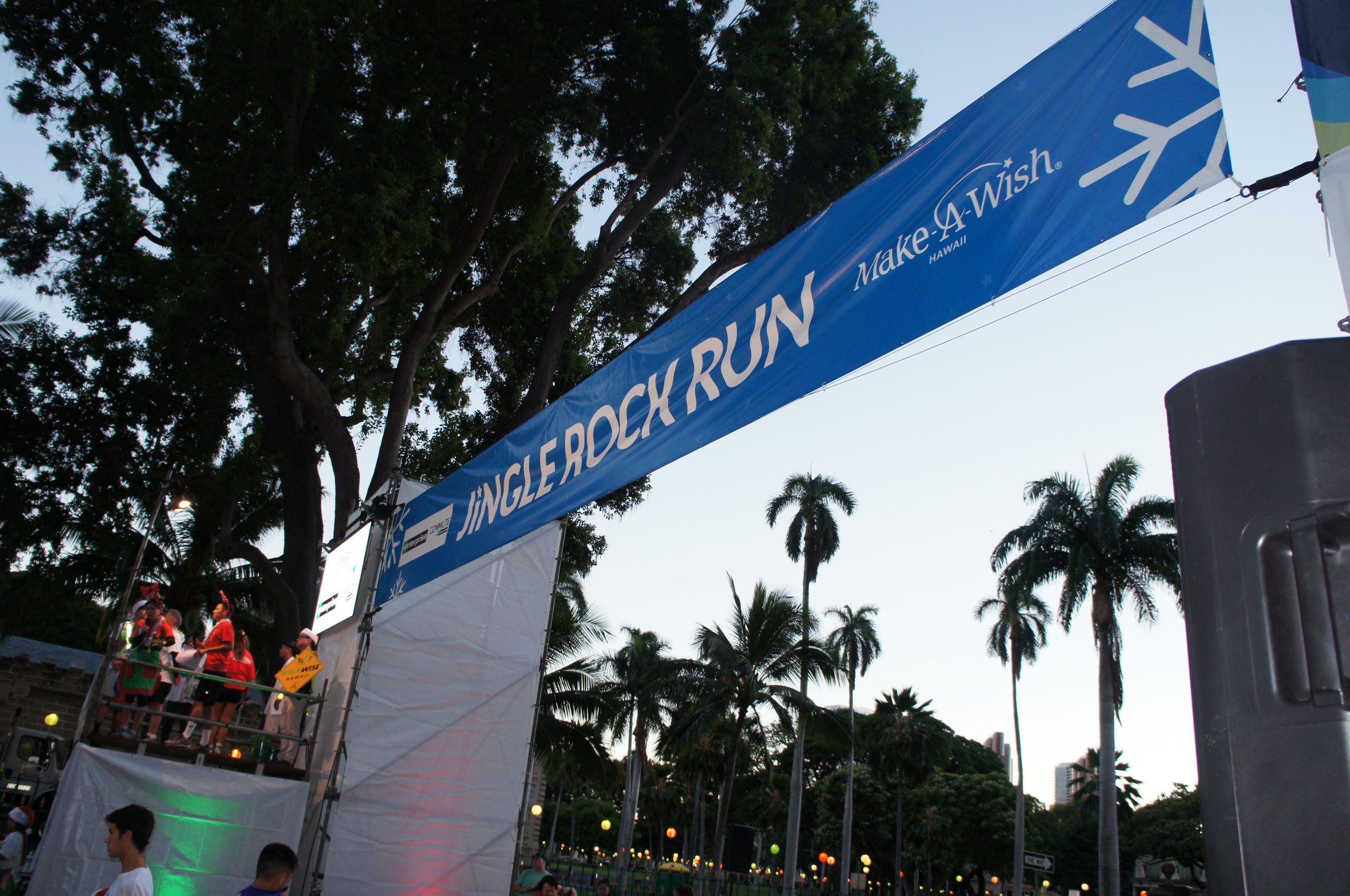 Jingle Rock Run banner at the beginning of run.
